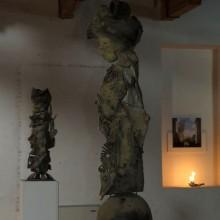 "Jean Hérard Celeur, ""Ezili Dantò"" and ""Atann pou delivèrans"", 2010,  wood, metal, tyres, nails.  Gabriel Rossell Santillán, Revolucion = The Death In This Garden, 2010, C-print mounted on aluminium, sugar frame, 58 x 66 cm"